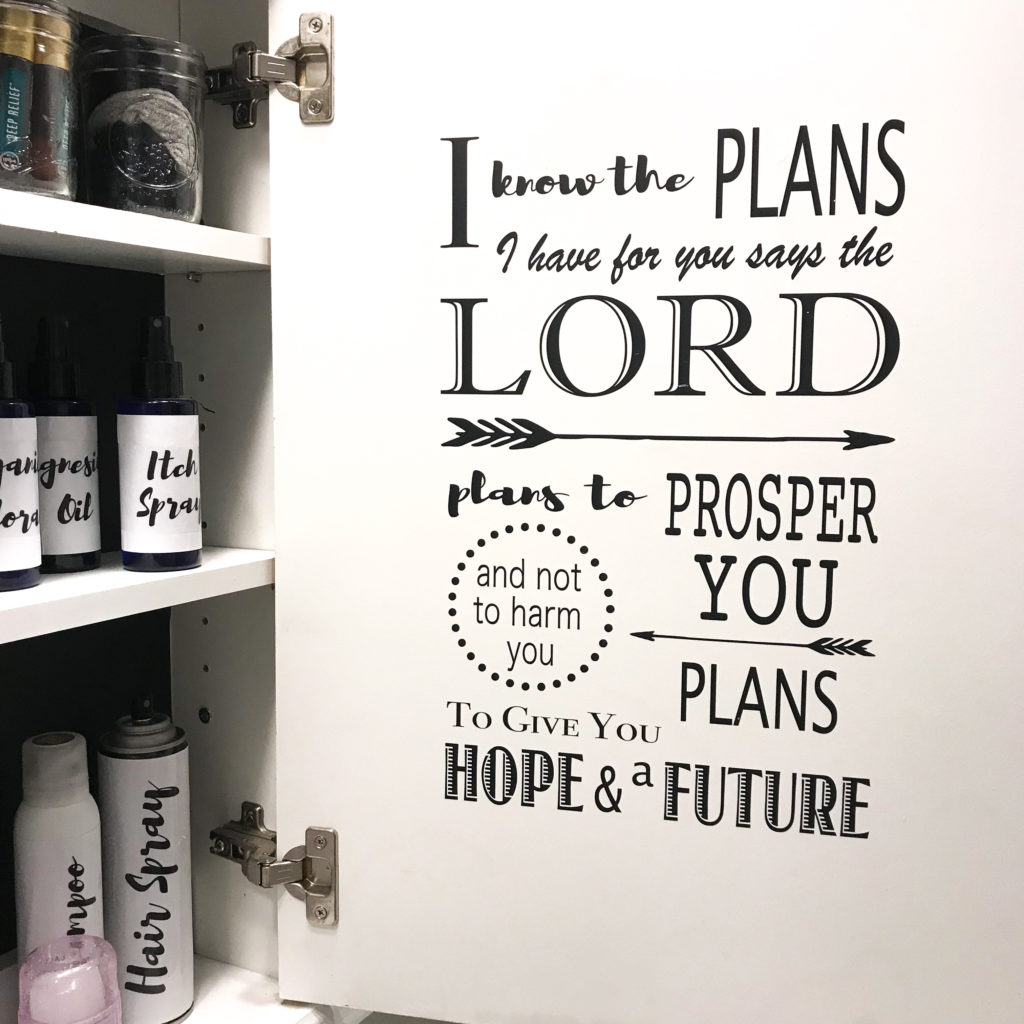 medicine cabinet with a bible verse inside the door as a daily reminder