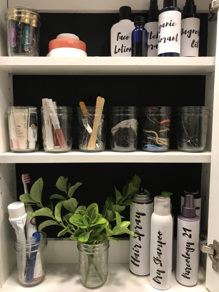 organized medicine cabinet with a black background